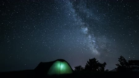 kaide : Rotating milky way above tent at night time lapse