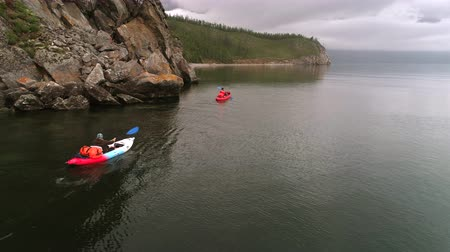 kayak : Two canoes on the lake. Tourists canoeing on the Bay. Aerial drone shot.