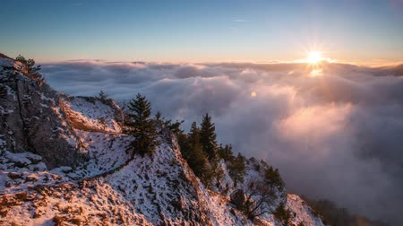 Sun, mountain landcape above clouds, nice nature time lapse