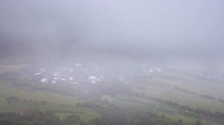 Village at mist and clouds, Time lapse