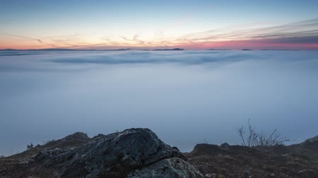 Landcape at sunrise over clouds - Time lapse motion video