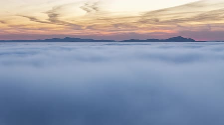 Sunset over clouds mist in mountain landcape at sunrise, Time lapse, Slovakia Стоковые видеозаписи