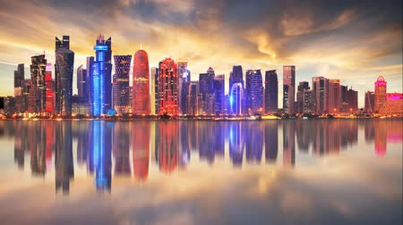 Skyline of modern city of Doha in Qatar, Middle East - Time lapse at sunset