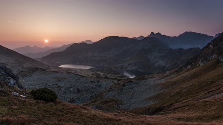 Time lapse of sunrise in mountains. Landscape with sun, Slovakia Tatras