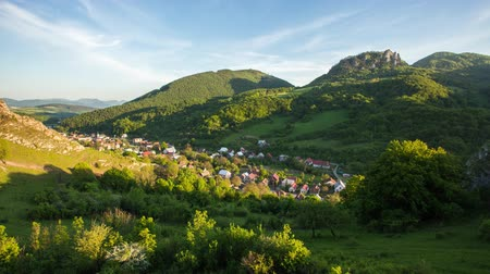 Time lapse of spring landcape with village and green forest, Slovakia