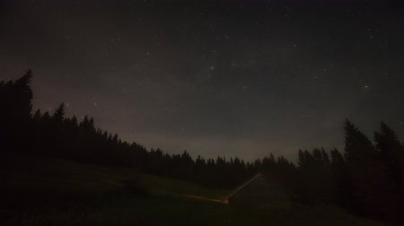Night view of mountain stars with cottage - Time lapse