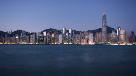 victoria : Hong Kong Skyline of Urban Architecture from night to sunrise