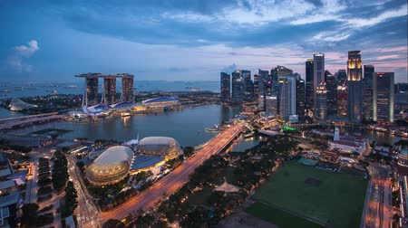 Singapore business district and city - Time lapse from sunset to night
