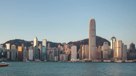 Victoria Harbor of Hong Kong city - Time lapse at sunset