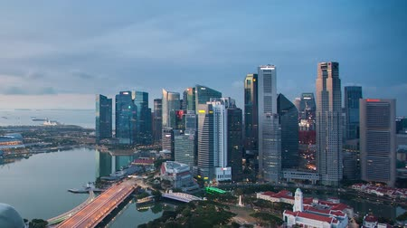 Time lapse of Singapore business district and city at twilight, Asia