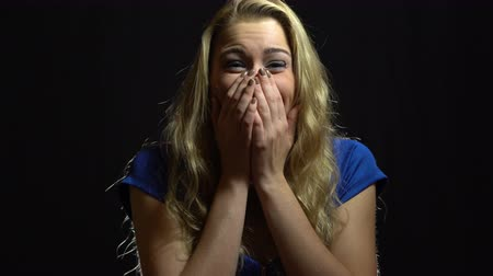 Beautiful Sexy Blonde Girl in Blue Dress is Surprised and Excited in Studio with Black Background. Стоковые видеозаписи