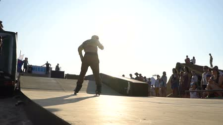 inline : Demonstration Performances Of rollerblading. Athletes making tricks on roller-skates contest at the festival Z-games Ukraine 2017 Stock Footage