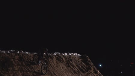 backflip : 20AUG2017, Odessa, Ukraine. real time video of extreme Athlete man Doing an amazing trick on the MTB Bmx Bike While Dirtjumping at Night at the Festival Extreme Ukraine 2017