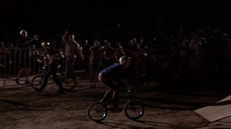 20AUG2017, Odessa, Ukraine. Slow motion of extreme man Athletes are Doing a Back Flip trick on the MTB Bmx Bike While Dirtjumping at Night at the Festival Extreme Ukraine 2017