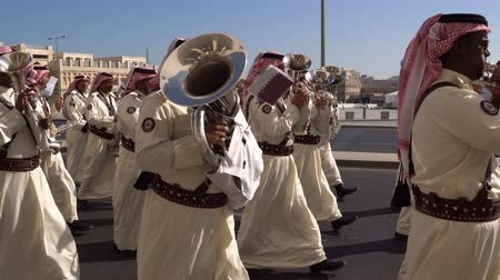 DOHA, QATAR - 14 FEBRUARY 2018: Orchestra Parade in Honor of the Qatarian Emir at Souq Waqif District, Old City, Doha, Qatar.
