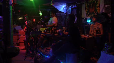 KRABI, THAILAND - 20 FEBRUARY 2018: A Multi-Ethnic band Performing live music in the Beach Bar in Railey Beach.