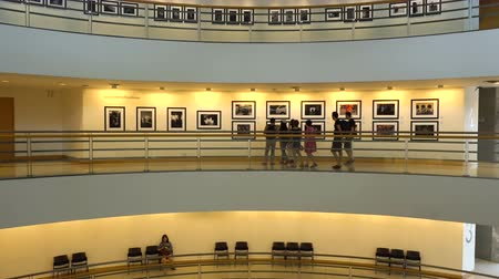 press wall : BANGKOK, THAILAND - 7 MAR 2018: Timelapse View Visitors Look Art Photos at Exhibition in Circle Shaped Museum of Contemporary Art in Bangkok.