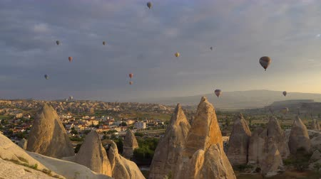 TURKEY, GOREME - MAY 20. Lots of hot air balloons flying over valleys in Goreme, Turkey. Tourists from all over the world come to Cappadocia to make a trip in a hot-air balloons.
