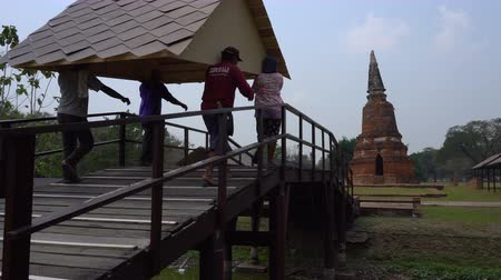 Thailand, Auytthaya - 15Mar 2018: Thai Asian People Workers Volunteers are Carry the Roof by the Bridge on the Ancient Buddha Temple Area in Auytthaya