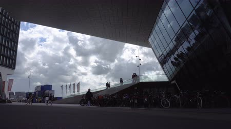 AMSTERDAM, NETHERLANDS - 23 AUG 2018: timelapse video trafic near the modern Eye Film Museum on the North part of Amsterdam city, Noord, Overhoeks. Popular Travel Destination. Cloudy weather.