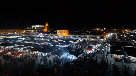 MOROCCO - MARRAKECH JAN 2019: Timelapse Night view of Djemaa el Fna, a square and market place in Marrakech medina quarter