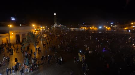 MOROCCO - MARRAKECH JAN 2019: Night view of Djemaa el Fna, a square and market place in Marrakesh medina quarter Стоковые видеозаписи