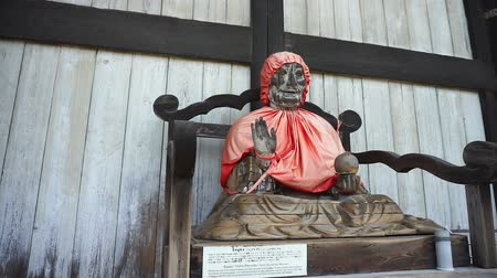 světové dědictví : NARA, JAPAN - APRIL 30 : Wooden statue of a seated Binzuru Pindola Bharadvja in Todai-ji temple,  Nara is a major tourism destination in Japan at Todai-ji temple on April 30, 2017 in Nara, Japan