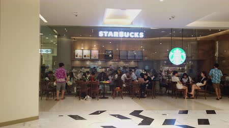 franczyza : BANGKOK , Thailand - APRIL 15 : Hyperlapse of Starbucks cafe at Siam Paragon Department store. Starbucks is the worlds largest coffee house chain in the world on April 15, 2019 in Bangkok, Thailand