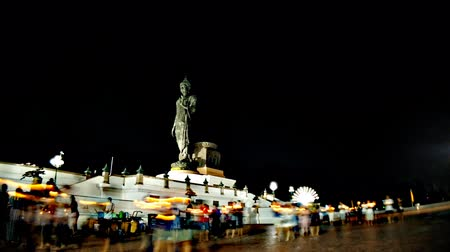 Motion time lapse of people walking pass the side of buddha in Visakha Bucha Day at Buddhist park in Phutthamonthon district, Nakhon Pathom Province of Thailand. (The important day of buddha religion) Vídeos