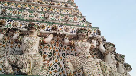 Ancient Hanuman figure around the base of pagoda of Wat Arun. Wat Arun is famous Buddhist temple in Thailand.