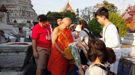 BANGKOK THAILAND - JANUARY 1 : Hyperlapse of unidentified people make merit with monk at the Temple of Dawn Wat Arun in New year festival on January 1, 2020 in Bangkok, Thailand.