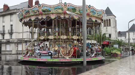 карусель : Merry-Go-Round carousel on a rainy day, reflection on the pavement, France