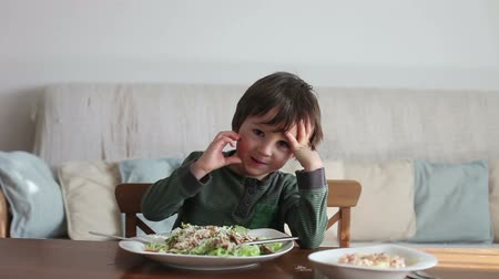 salad : Adorable little boy, eating salad at home, home made salad Stock Footage