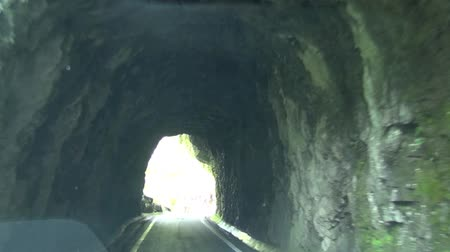 no traffic : driving on the mountain path and tunnel of rock