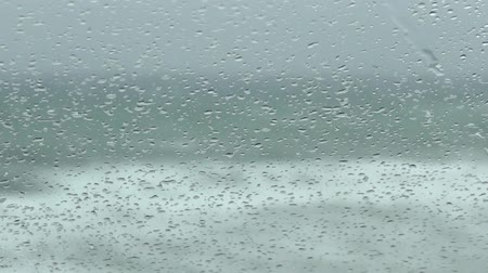 veículo aquático : rain on the windshield of car with sea waving background
