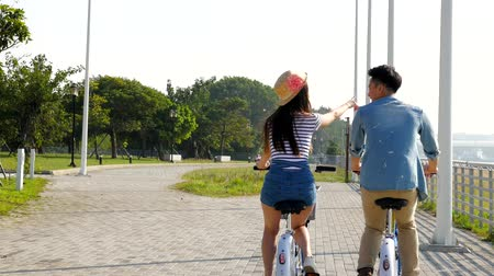 kolo : happy young couple biking in the park