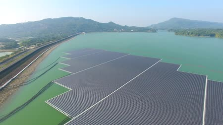 kolektor : Aerial view of Floating solar panels or solar cell Platform on the lake