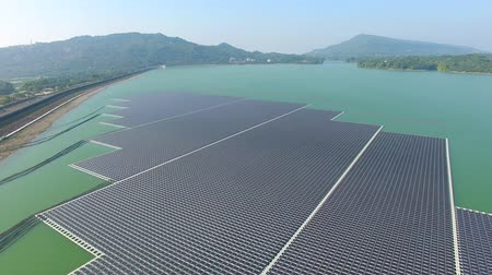 gyűjtő : Aerial view of Floating solar panels or solar cell Platform on the lake