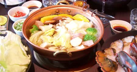 hot pot : Sliced beef in the hot pot soup for Shabu Shabu Stock Footage