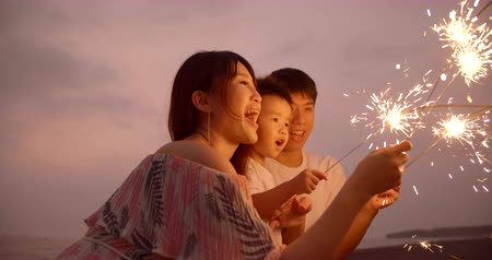 happy family celebrating new year with sparklers Stok Video