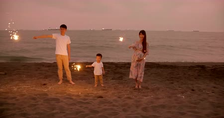 happy family celebrating new year with sparklers 影像素材