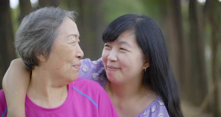 objetí : Cheerful mature woman embracing senior mother