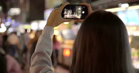 aparat : happy young asian woman using smart phone in Night Market