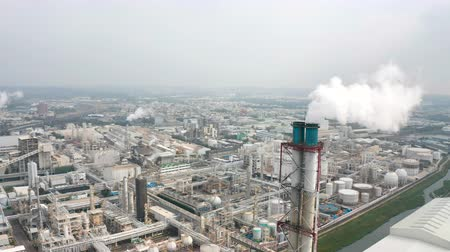 дымоход : Aerial view of industrial area with chemical plant. Smoking chimney from factory Стоковые видеозаписи