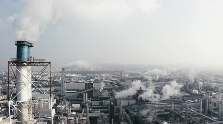 Aerial view of industrial area with chemical plant. Smoking chimney from factory 影像素材