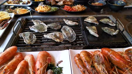 shellfish dishes : Time lapse of BBQ oyster on grill at restaurant