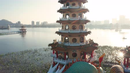 cienie : Aerial view lotus pond and traditional Chinese Pagoda at sunrise, Kaohsiung, Taiwan. Asia Wideo