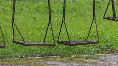 old swing steel in raining day Stok Video