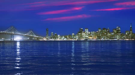 состояние : San Francisco skyline in California sunset with reflection in water bay USA