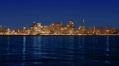 используемый : San Francisco skyline in California sunset with reflection in water bay USA